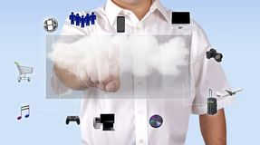 Man Accessing Media Content Through Cloud Computing. Man dressed in a casual attire, accessing media content through cloud computing, via a hologram screen stock images