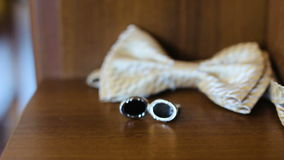 Man accessories, cufflinks, grooms bow-tie stock video footage