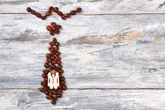 Man accessory from coffee beans. Stock Photos