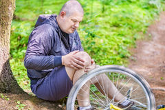 Man in accident with bicycle Stock Photos