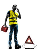 Man accident breakdown telephone silhouette. One  man accident breakdown on the  telephone  with safety vest silhouette isolated in white background Royalty Free Stock Image