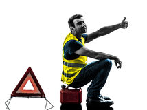 Man accident yellow vest warning triangle silhouette. One man with yellow vest car breakdown waiting isolated on white background Royalty Free Stock Image