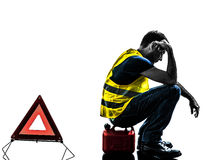 Man accident yellow vest warning triangle silhouette Stock Photography