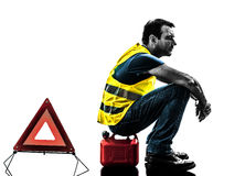 Man accident yellow vest warning triangle silhouette Stock Photos