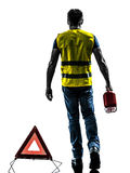 Man accident yellow vest warning triangle silhouette. One man with safety vest silhouette isolated in white background Stock Photos