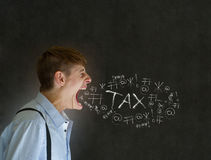 Angry man shouting at chalk income tax. Man accountant, teacher, or businessman big mouth angry and shouting at chalk tax on blackboard background Stock Image