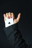 Man with ace up his sleeve Stock Photo
