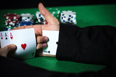 Man with ace up his sleeve Royalty Free Stock Photography