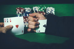 Man with ace up his sleeve Royalty Free Stock Image