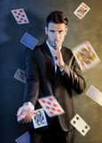 Man with ace up his sleeve Stock Photography