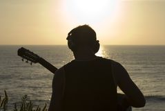 Man with acoustic guitar Royalty Free Stock Photography