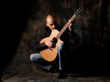 Man with acoustic guitar Royalty Free Stock Photo