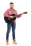 Man with a acoustic guitar Royalty Free Stock Images
