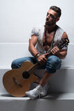 Man with Acoustic Guitar Sitting on Steps Stock Photos