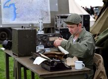 Man acting as war reporter for American army.