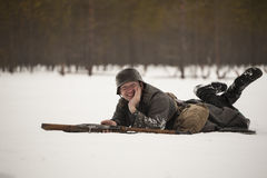 Man Acting WWII Finnish Soldier. Man acting a Finnish soldier is resting during WWII Reenactment in Russia stock image