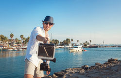 Man with action camera take a selfie photo in the tropical sea b Royalty Free Stock Photo