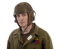 Man actor in military uniform of American tankman of World War II. Posing on white background royalty free stock photo