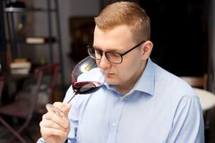 A man addicted to alcohol is drinking wine stock image