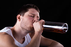Man addicted to alcohol Stock Photos