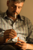 Man addicted to cigarette Royalty Free Stock Photography
