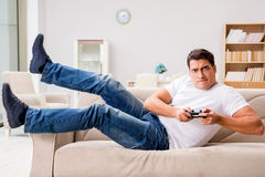 The man addicted to computer games Royalty Free Stock Photos