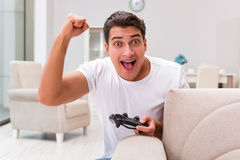 The man addicted to computer games Royalty Free Stock Photo