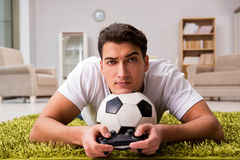 The man addicted to computer games Stock Image