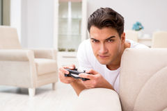 The man addicted to computer games Stock Photo