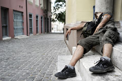 Man addicted to drugs lies on a doorstep Royalty Free Stock Photography