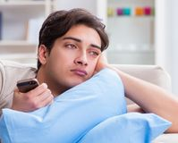 Man addicted to his mobile phone in bed stock photography