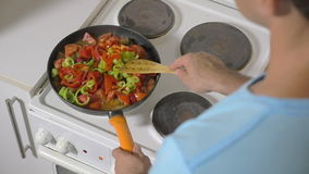 Man Adding Fresh Pepper into the Frying Pan stock video footage