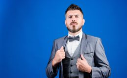 Man adjust suit with bow tie. Well groomed man with beard in formal suit jacket. Male fashion and aesthetic. Businessman. Formal outfit. Classic style aesthetic stock photos