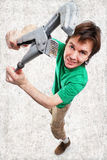 Man with adjustable spanner. Stock Images