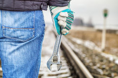 Man with adjustable wrench on the railroad Stock Image