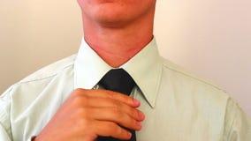 Man Adjusting Black Tie stock footage