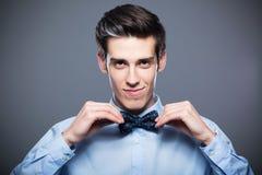 Man adjusting bow tie Royalty Free Stock Image