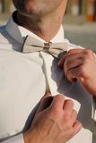 Man adjusting bow ties Stock Photos