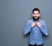 Man adjusting buttons on shirt Royalty Free Stock Photography