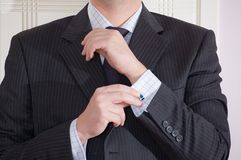 Man Adjusting Cufflink Stock Photography
