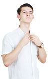 Man adjusting his shirt Royalty Free Stock Images