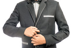 Man adjusting his suit. A young business man adjusting his suit before the big meeting Royalty Free Stock Photo