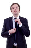 Man adjusting his tie Royalty Free Stock Photography