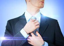 Man adjusting his tie. Business, formal clothes and dating - man adjusting his tie Royalty Free Stock Images