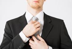 Man adjusting his tie. Close up of man adjusting his tie royalty free stock photo