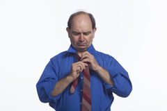 Man adjusting his tie, horizontal Stock Images