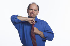 Man adjusting his tie, horizontal Royalty Free Stock Image