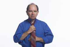 Man adjusting his tie, horizontal Stock Photo