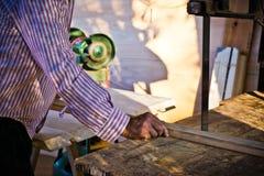 Man adjusting planer knives wood polishing machine Royalty Free Stock Photography