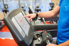 Man adjusting the settings of a treadmill Stock Photography
